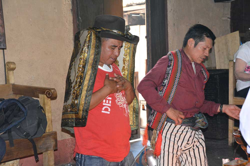 a Tz'utuhil shaman performs a blessing for a young man soon to emigrate to the U.S. The ceremony includes an offering to Rilaj Mam