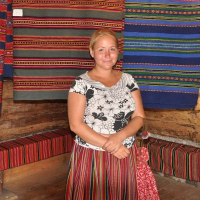 Estonian Woman and Rugs