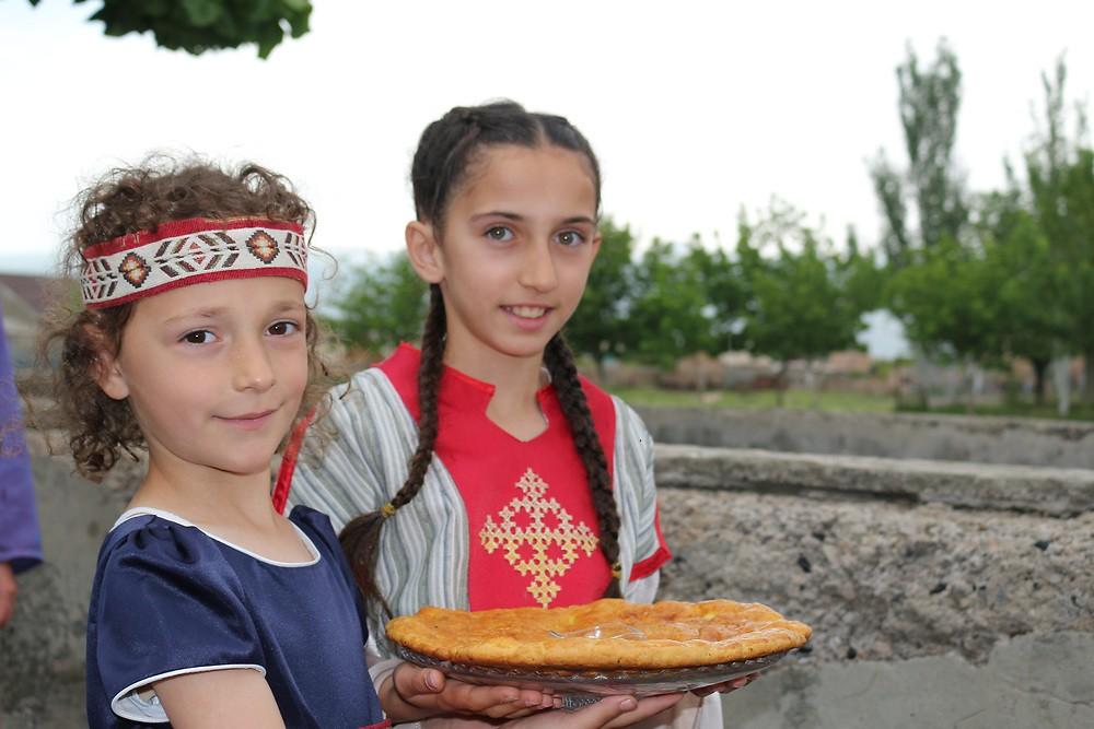 Schoolgirls of Sasunik warmly welcome visitors