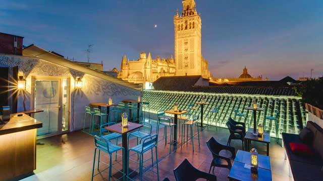 Best Things To Do In Seville | View of La Giralda from the rooftop of Hotel Hotel Dona Maria.
