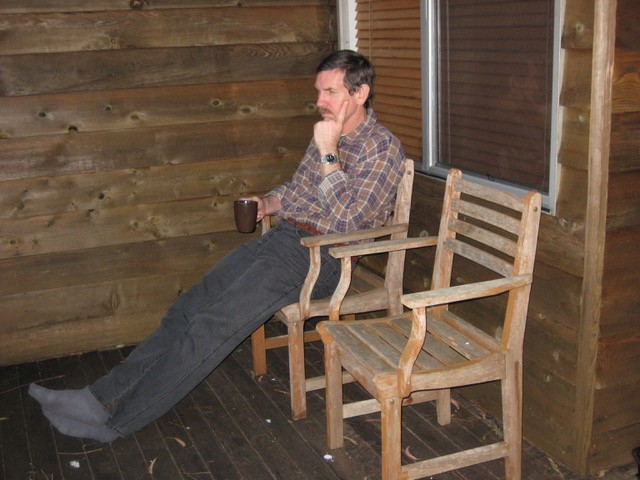 David relaxing with a cup of coffee at his cabin at Binna Burra at the end of a long day walking the 17.4-km Coomera Circuit.