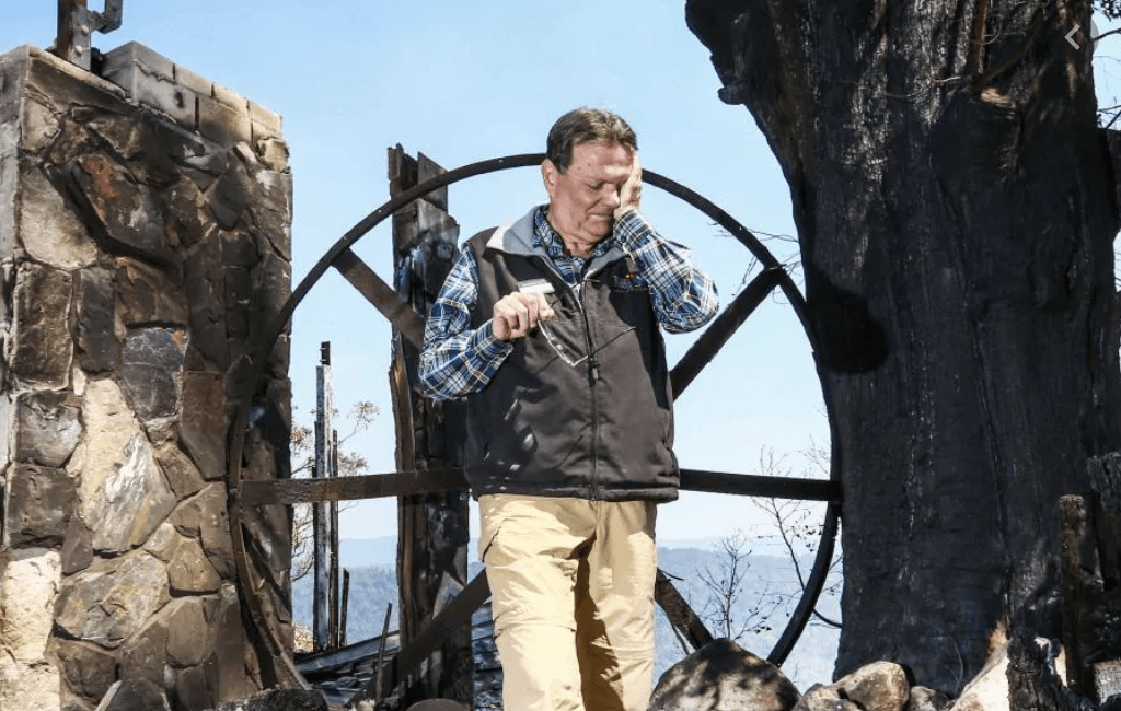 Steve Noakes, Binna Burra Lodge Board Chairperson, in a moment of grief after the fire.