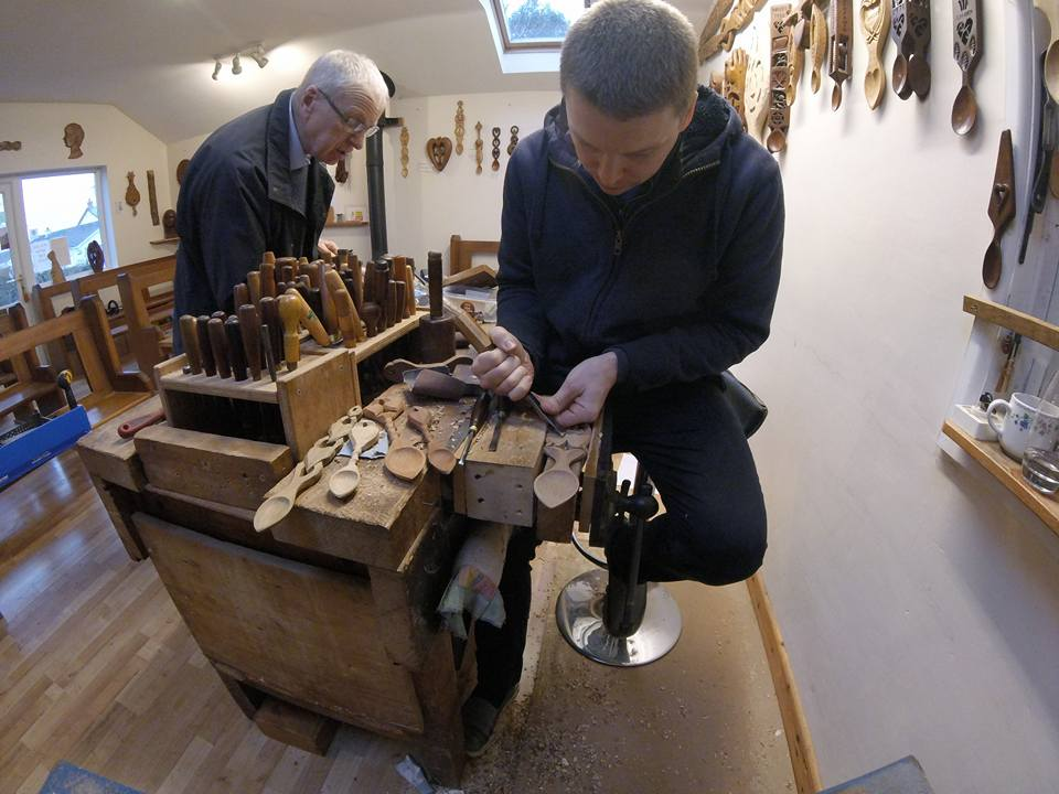 Father and son Kerry and Dave Thomas carrying on the ancient Welsh tradition of carving lovespoons. Photo: Lovespoon Workshop