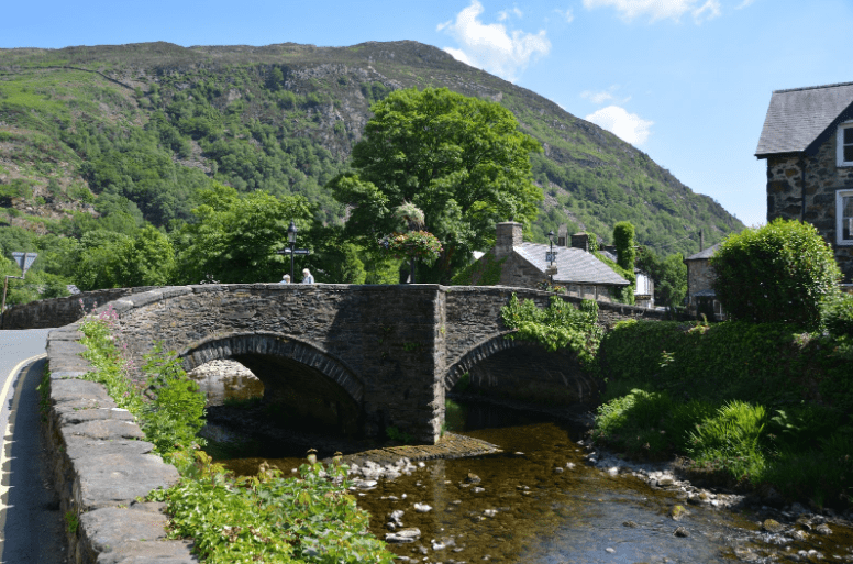 The River Glaslyn and River Colwyn flow quietly beneath the 17th century Beddgelert Bridge. Photo: Meg Pier